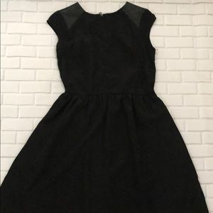 Black dress with faux leather patch
